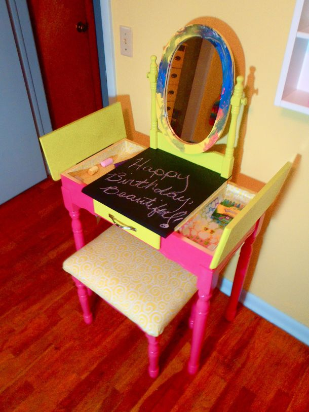 This is how it turned out. Because it is Olivia's art vanity, I let her paint the mirror herself. It may not coordinate with the rest of piece, but it's just perfect.