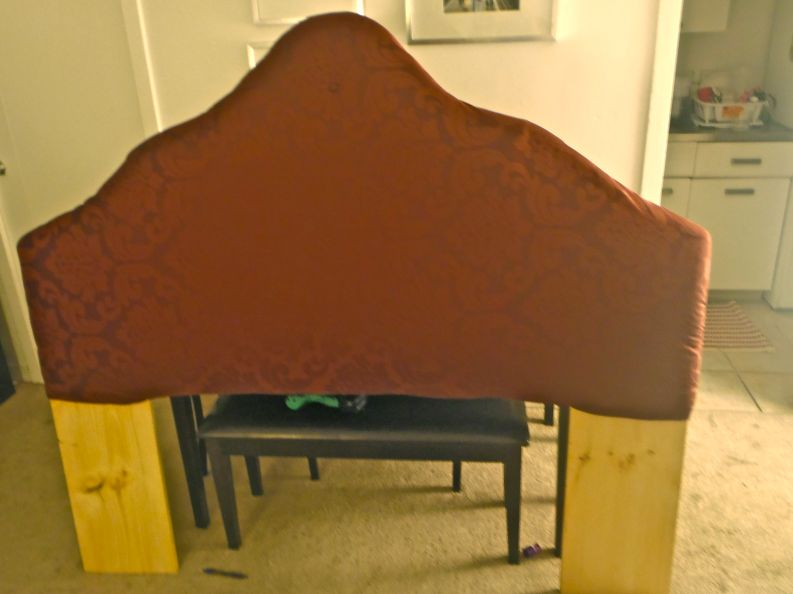 I used the staple gun to cover it with fabric first. I left it a little loose, not droopy or wrinkled, but with slack.
